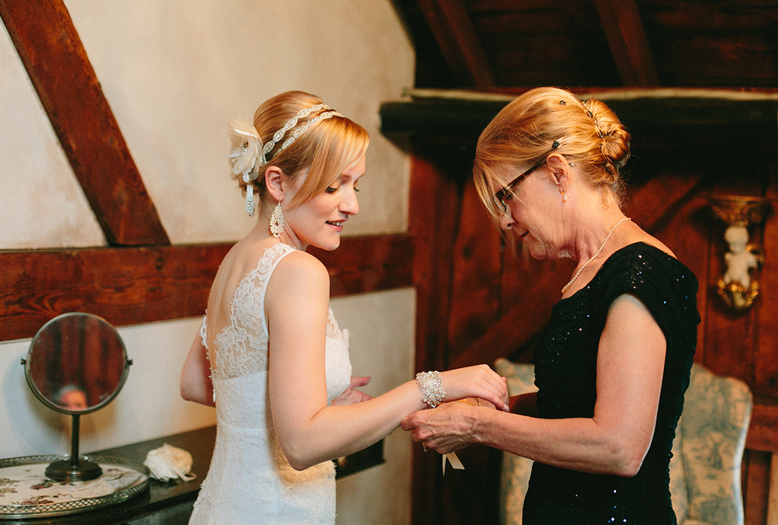 07_mother_helps_bride_barn_at_lang_farm_vermont_wedding