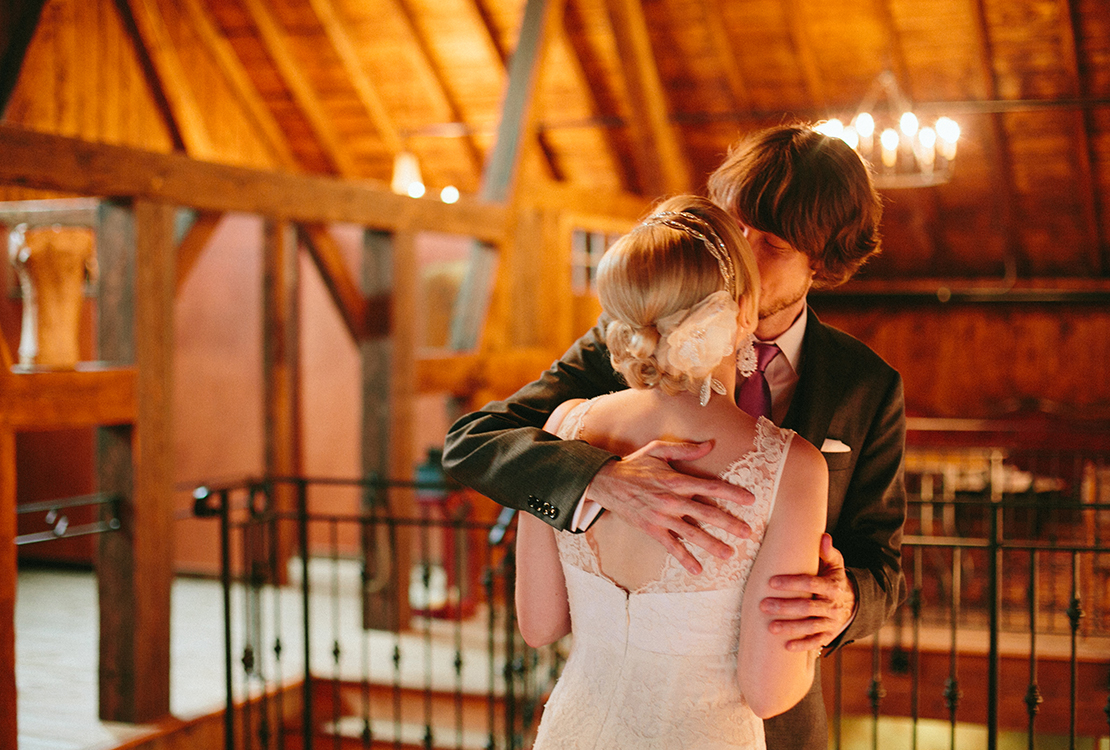 14_First_look_kiss_barn_at_lang_farm_essex_junction_vermont_wedding