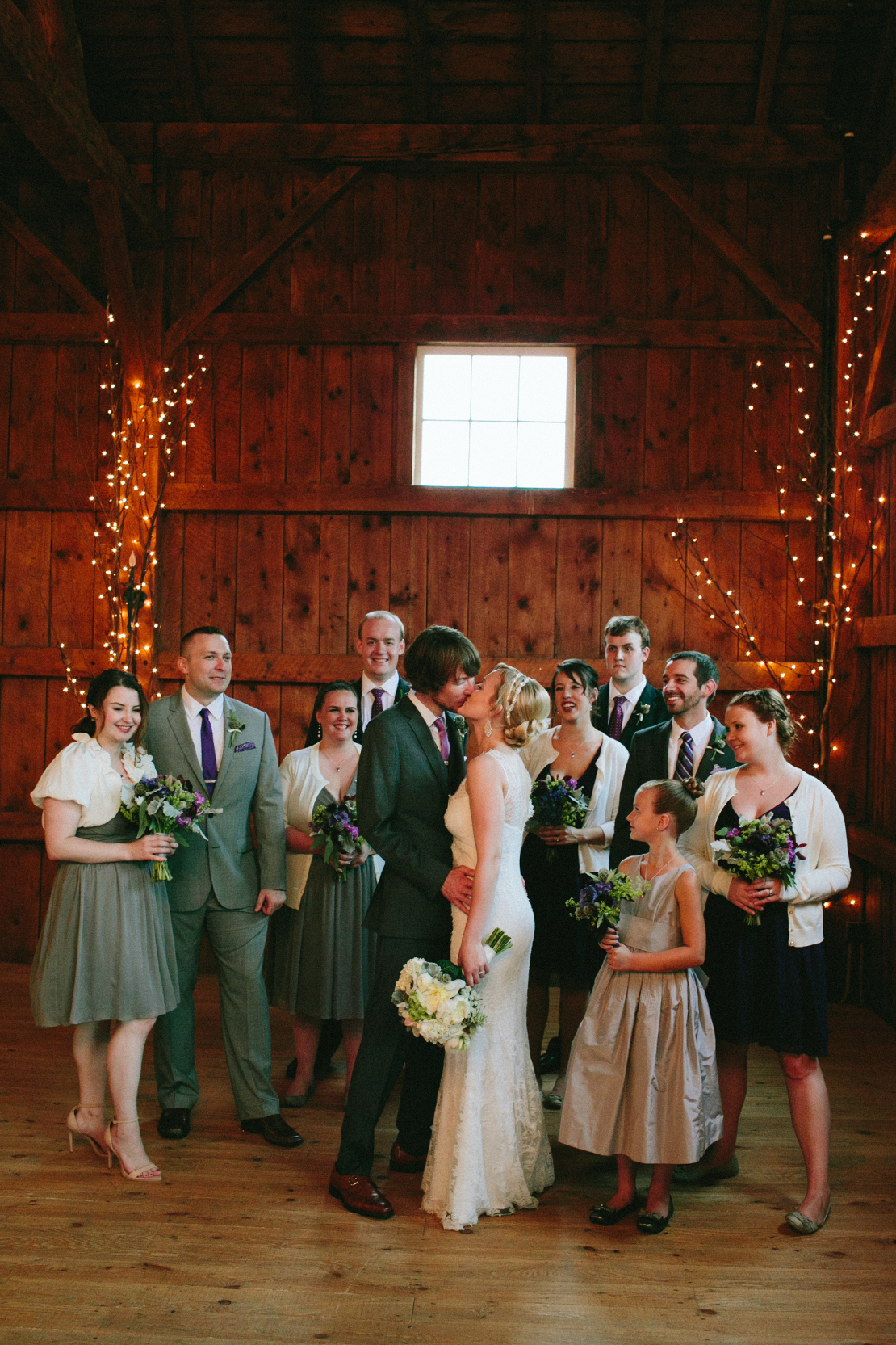21_bridal_party_laughing_indoor_portrait_barn_lang_farm_vermont_wedding