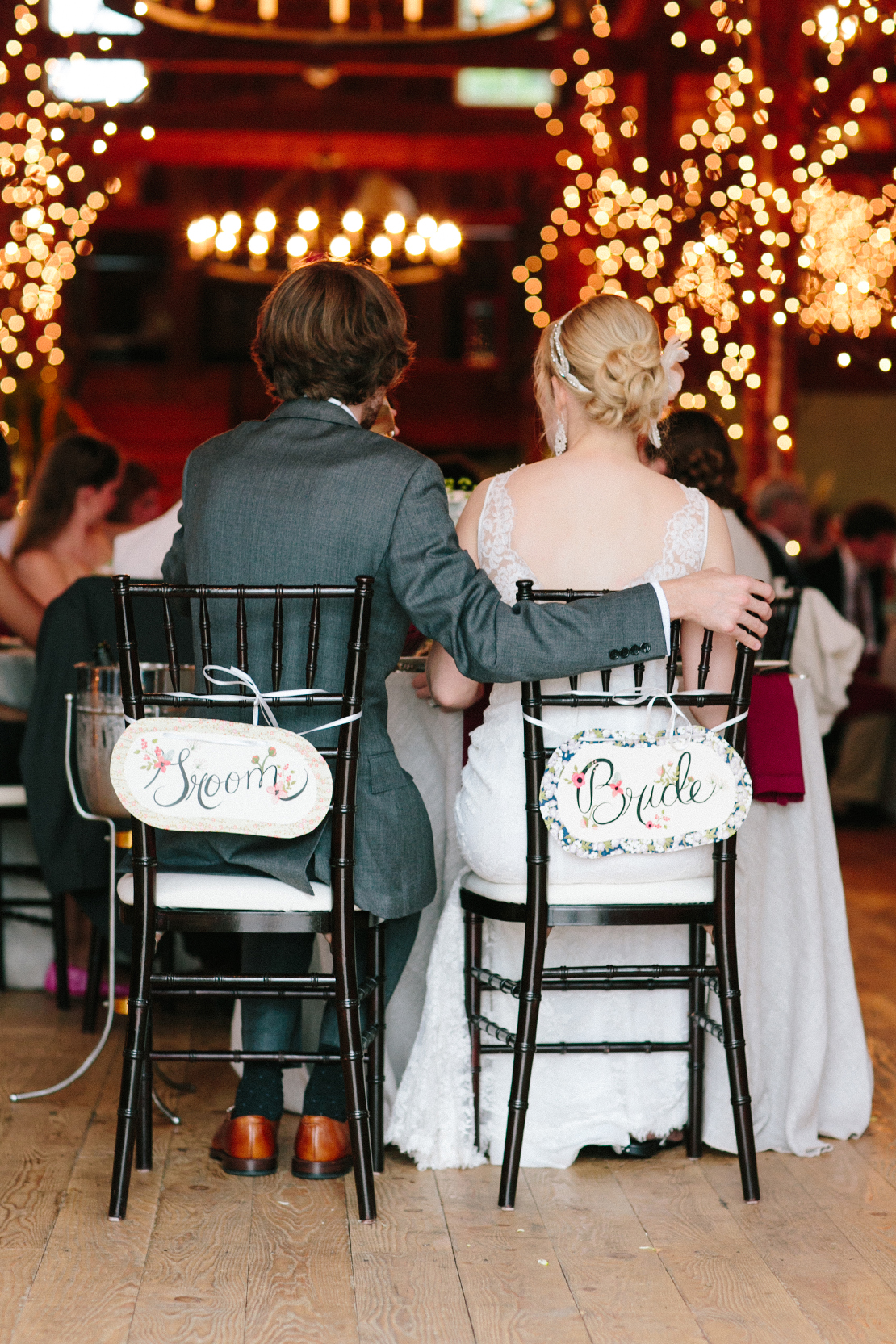 35_bride_groom_signs_backs_of_chairs_Barn_at_lang_farm_vermont_spring_wedding