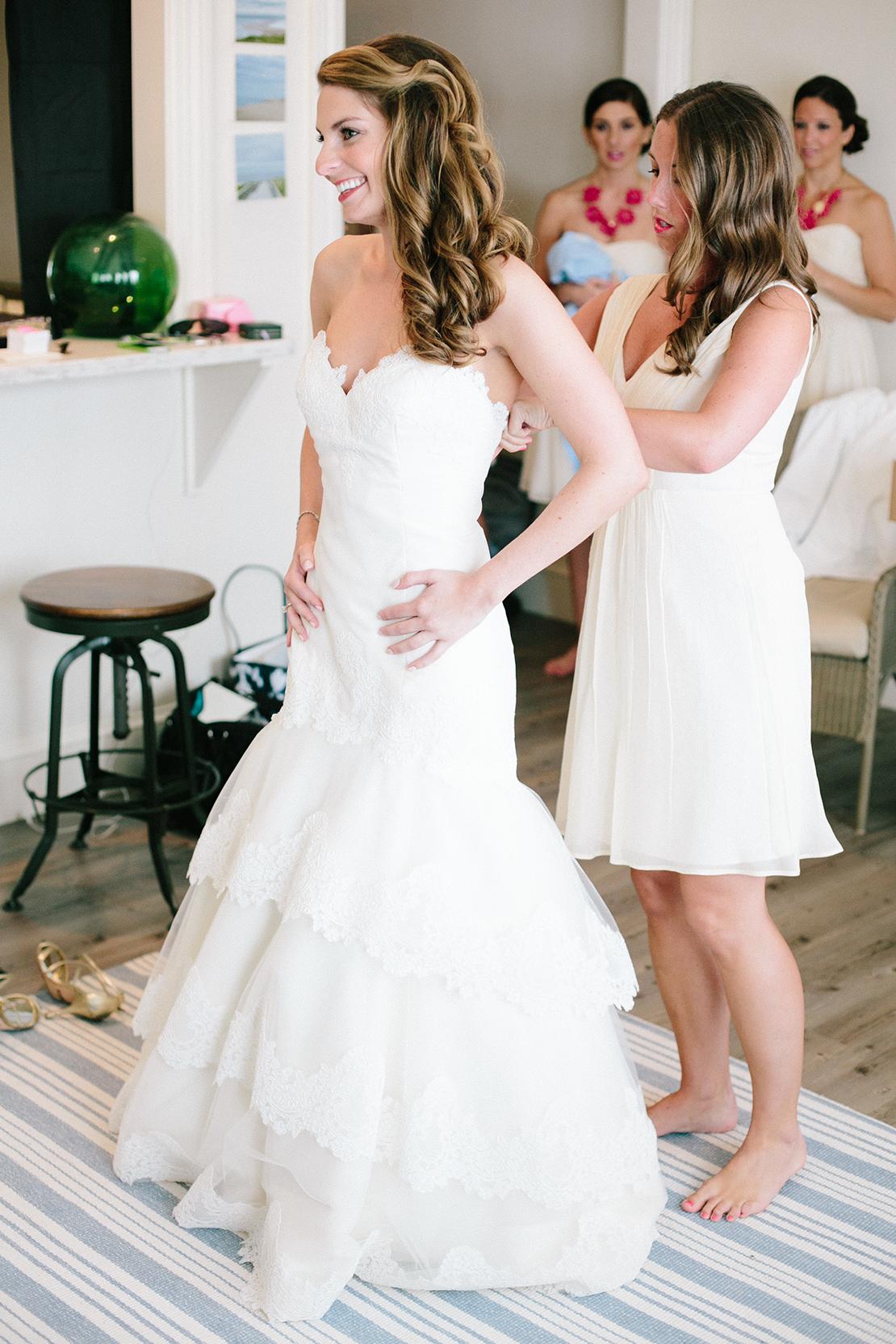 04_Wychmere_beach_club_wedding_putting_on_bridal_gown