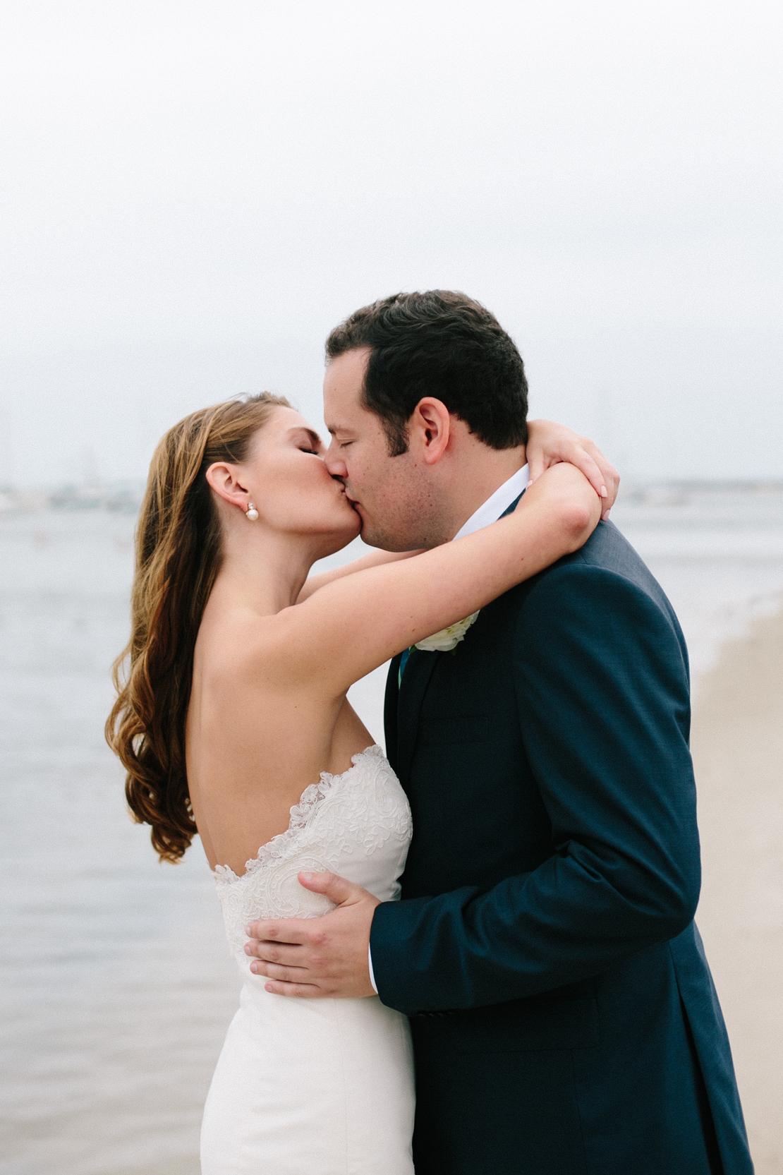 14_bride_groom_kiss_on_wychmere_beach_club_dock_wedding
