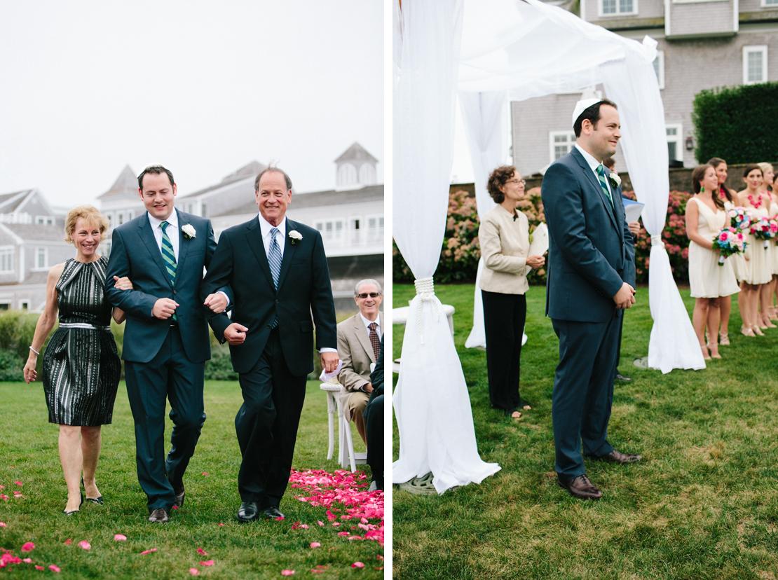 26_groom_walks_down_aisle_with_parents_jewish_cape_cod_wedding_photography_wychmere_beach_club
