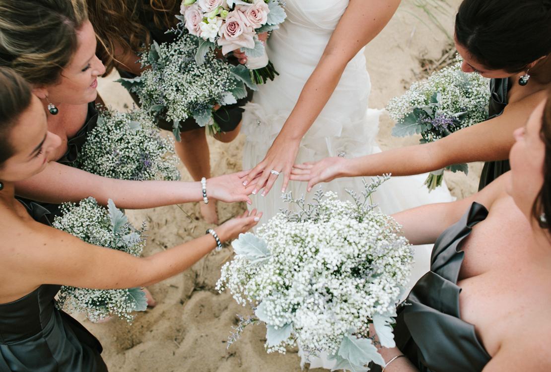 43_bridesmaids_admiring_brides_ring