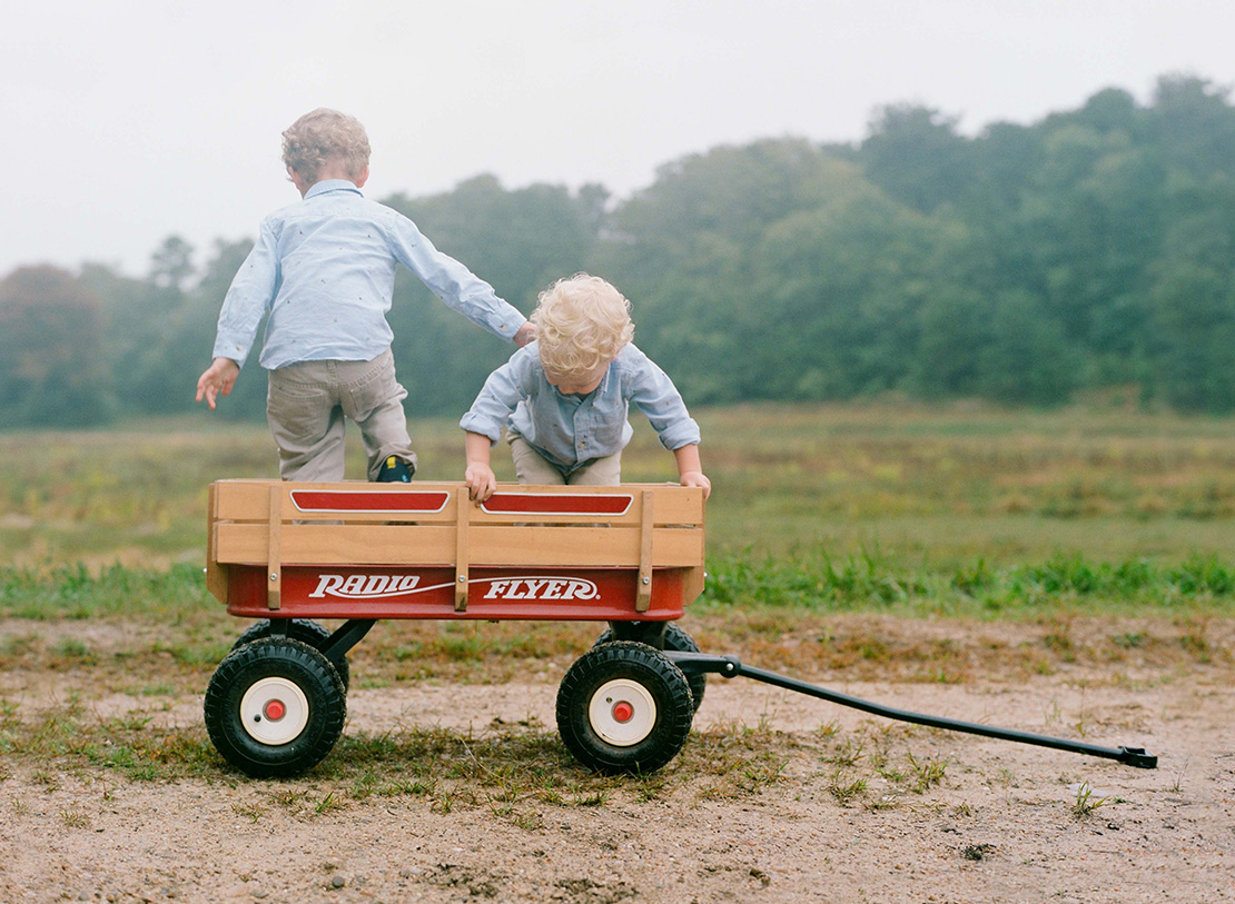 05_Little_boys_radio_flyer_red_wagon_play_lifestyle_family_portrait_cape_cod_cranberry_bog_heidi_vail