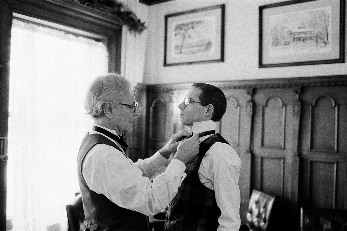 04_Father_Bride_Helping_son_in_law_with_bow_tie_groom_summit_manor_saint_paul