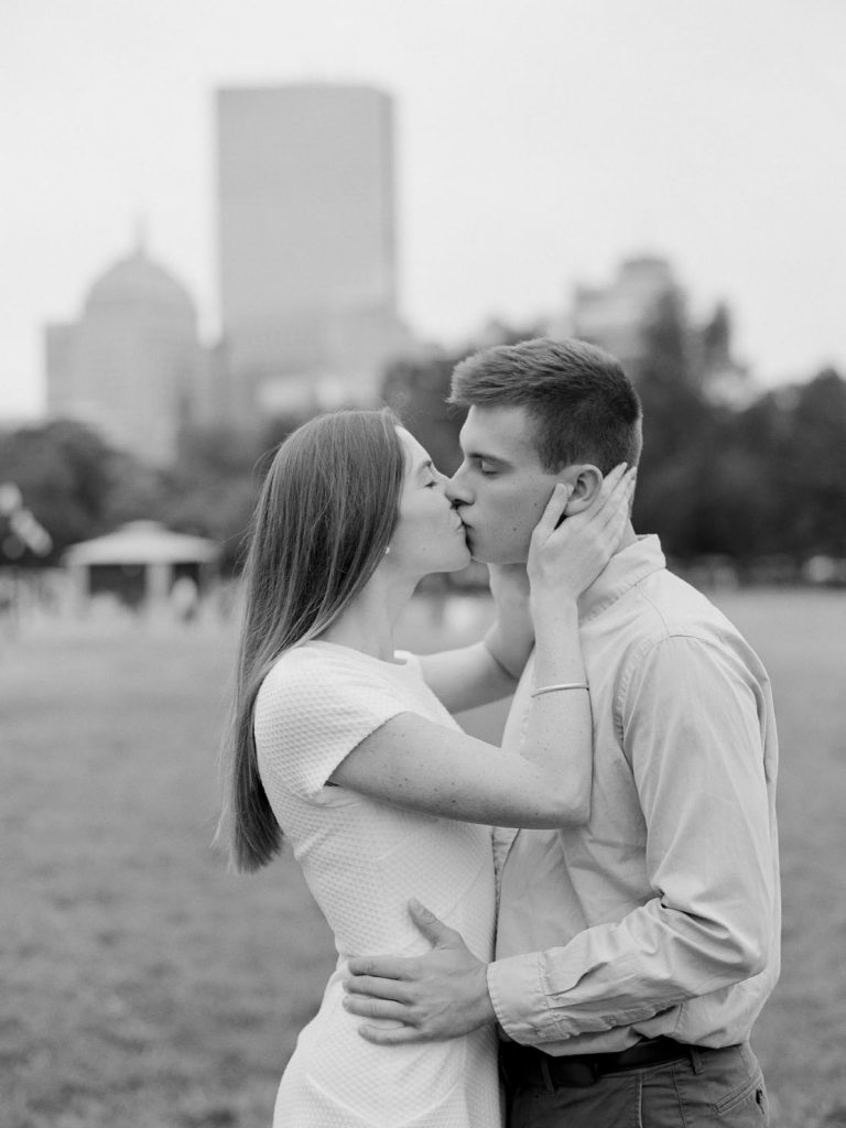 Boston Skyline view from Common | Sweet kisses during Boston engagement session | Heidi Vail Photography